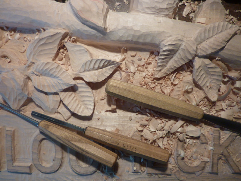 Chisels and carved leaves